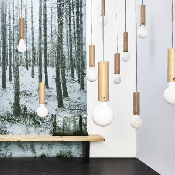 Glowing pendant lights with Forest Blue wallpaper