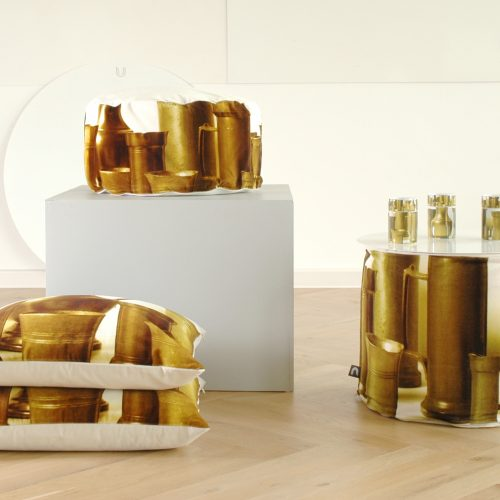 Velvet poufs and pillows in the colored yellow print of pewter pots